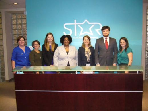 Students in front of STAR logo1